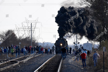 Stock Photo of People watch the Union Pacific's historic Big Boy steam locomotive No. 4014 travel through Oologah, Okla., . The locomotive is touring through the Union Pacific system in 2019 to commemorate the transcontinental railroad's 150th anniversary