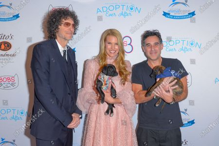 Howard Stern, Beth Ostrosky Stern and Joshua Radin attend the North Shore Animal League, America's Annual Get Your Rescue On Gala at Pier Sixty New York City
