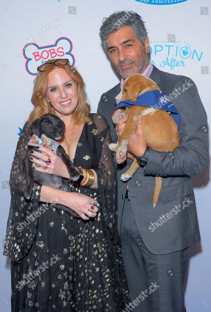 Stock Picture of Jenny Hutt and Keith Hutt attend the North Shore Animal League, America's Annual Get Your Rescue On Gala at Pier Sixty New York City