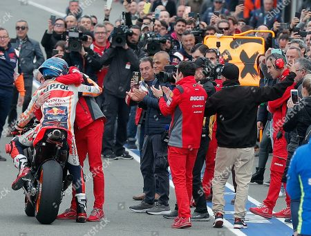 Spanish MotoGP rider Jorge Lorenzo (L) hugs a member of his team after he won Comunitat Valenciana GP race, the season's last race, at Ricardo Tormo Circuit, in Cheste, Valencia, eastern Spain, 17 November 2019.