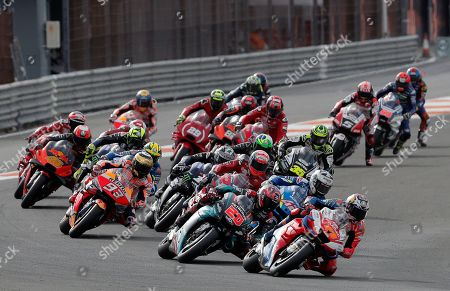 Australian MotoGP rider Jack Miller (R) takes a bend ahead of French Fabio Quartararo (C, 20) and Spaniard Alex Rins (2-R, 42) during Comunitat Valenciana GP race, the season's last race, at Ricardo Tormo Circuit, in Cheste, Valencia, eastern Spain, 17 November 2019.