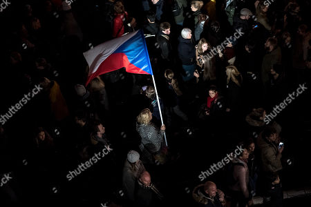 A woman holds a Czech national flag near the memorial to students who were attacked by riot police in 1989 on Narodni street, marking the 30th anniversary of the Velvet Revolution in Prague, Czech Republic, 17 November 2019. The Czech Republic celebrates the 30th anniversary of the Velvet Revolution commemorating the events of 17 November 1989, when after the brutal suppression of a student demonstration at Narodni street, the communist leadership soon crumbled and the playwright and human rights activist Vaclav Havel became president shortly thereafter.