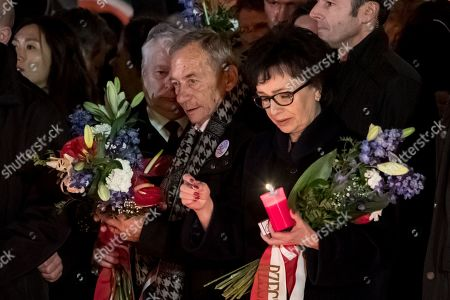 Polish Sejm Speaker Elzbieta Witek (R) holds a candle at the memorial to students who were attacked by riot police in 1989 on Narodni street, marking the 30th anniversary of the Velvet Revolution in Prague, Czech Republic, 17 November 2019. The Czech Republic celebrates the 30th anniversary of the Velvet Revolution commemorating the events of 17 November 1989, when after the brutal suppression of a student demonstration at Narodni street, the communist leadership soon crumbled and the playwright and human rights activist Vaclav Havel became president shortly thereafter.