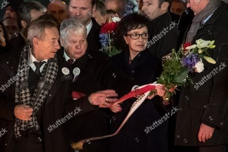 Polish Sejm Speaker Elzbieta Witek (R) and Polish Deputy Sejm Speaker Bogdan Borusewicz (C) at the memorial to students who were attacked by riot police in 1989 on Narodni street, marking the 30th anniversary of the Velvet Revolution in Prague, Czech Republic, 17 November 2019. The Czech Republic celebrates the 30th anniversary of the Velvet Revolution commemorating the events of 17 November 1989, when after the brutal suppression of a student demonstration at Narodni street, the communist leadership soon crumbled and the playwright and human rights activist Vaclav Havel became president shortly thereafter.