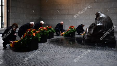 Stock Photo of (L-R) German Defense Minister Annegret Kramp-Karrenbauer, the Vice President of the German Parliament Wolfgang Kubicki, German President Frank-Walter Steinmeier, the President of the Federal Council Bundesrat in Germany Dietmar Woidke and the Vice President of the German Constitutional Court Stephan Harbarth during a wreath laying ceremony at the memorial site 'Neue Wache' (New Guardhouse) to commemorate the national day of mourning for the victims of war and dictatorship, in Berlin, Germany, 17 November 2019. The so-called 'Volkstrauertag' (lit.: People's Day of Mourning) is annually held in Germany two Sundays ahead of the first Advent day. It remembers and pays respect to all victims - civilans and soldiers - who died in wars, armed conflicts and under violent oppression.