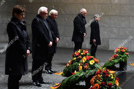 Stock Image of (L-R) German Defense Minister Annegret Kramp-Karrenbauer, the Vice President of the German Parliament Wolfgang Kubicki, German President Frank-Walter Steinmeier, the President of the Federal Council Bundesrat in Germany Dietmar Woidke and the Vice President of the German Constitutional Court Stephan Harbarth during a wreath laying ceremony at the memorial site 'Neue Wache' (New Guardhouse) to commemorate the national day of mourning for the victims of war and dictatorship, in Berlin, Germany, 17 November 2019. The so-called 'Volkstrauertag' (lit.: People's Day of Mourning) is annually held in Germany two Sundays ahead of the first Advent day. It remembers and pays respect to all victims - civilans and soldiers - who died in wars, armed conflicts and under violent oppression.