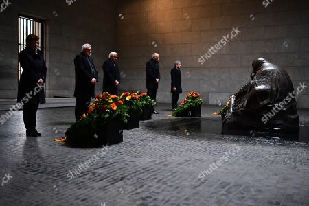 Stock Picture of (L-R) German Defense Minister Annegret Kramp-Karrenbauer, the Vice President of the German Parliament Wolfgang Kubicki, German President Frank-Walter Steinmeier, the President of the Federal Council Bundesrat in Germany Dietmar Woidke and the Vice President of the German Constitutional Court Stephan Harbarth during a wreath laying ceremony at the memorial site 'Neue Wache' (New Guardhouse) to commemorate the national day of mourning for the victims of war and dictatorship, in Berlin, Germany, 17 November 2019. The so-called 'Volkstrauertag' (lit.: People's Day of Mourning) is annually held in Germany two Sundays ahead of the first Advent day. It remembers and pays respect to all victims - civilans and soldiers - who died in wars, armed conflicts and under violent oppression.