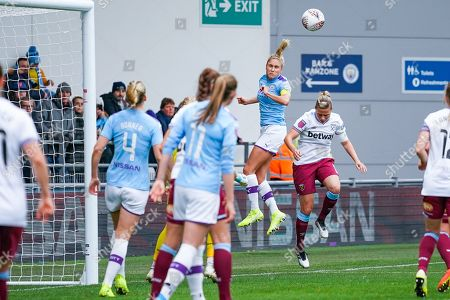 Manchester City Women defender Steph Houghton (captain) (6) heads the ball during the FA Women's Super League match between Manchester City Women and West Ham United Women at the Sport City Academy Stadium, Manchester
