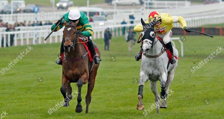 DEFI DU SEUIL (Barry Geraghty) beats POLITOLOGUE (right) in The Shloer Chase Cheltenham