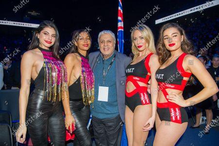 Stock Photo of Enrico Macias and Ring Girls