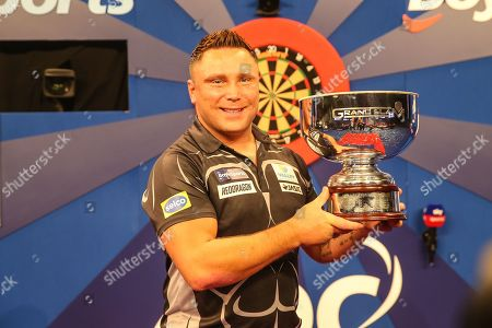 Gerwyn Price wins and holds aloft The Eric Bristow Trophy during the Grand Slam of Darts, at Aldersley Leisure Village, Wolverhampton