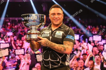 Stock Image of Gerwyn Price wins and holds aloft The Eric Bristow Trophy during the Grand Slam of Darts, at Aldersley Leisure Village, Wolverhampton