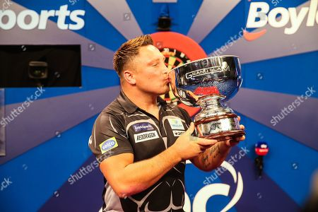Stock Picture of Gerwyn Price wins and holds aloft The Eric Bristow Trophy during the Grand Slam of Darts, at Aldersley Leisure Village, Wolverhampton
