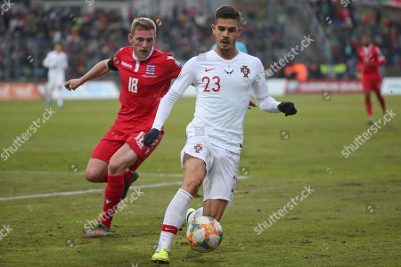 Portugal's Andre Silva, right, and Luxembourg's Laurent Jans fight for the ball during the Euro 2020 group B qualifying soccer match between Luxembourg and Portugal at the Josy Barthel stadium in Luxembourg