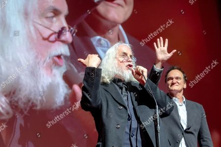 American cinematographer Robert Richardson (L) and US film director Quentin Tarantino (R) join the closing gala of the 27th edition of the EnergaCamerimage Festival, in Torun, Poland, 16 November 2019 (issued 17 November 2019). Richardson and Tarantino were honored with the festival's director-cinematographer duo award. The film festival ran from 09 to 16 November 2019.