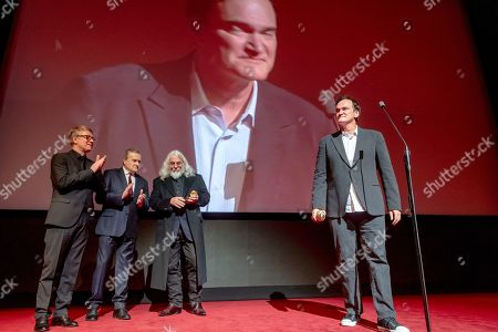 American cinematographer Robert Richardson (3-L) and Polish Deputy Prime Minister and Minister of Culture Piotr Glinski (2-L) listen to US film director Quentin Tarantino (R) speaking at the closing gala of the 27th edition of the EnergaCamerimage Festival, in Torun, Poland, 16 November 2019 (issued 17 November 2019). Richardson and Tarantino were honored with the festival's director-cinematographer duo award. The film festival ran from 09 to 16 November 2019. Others are not identified.