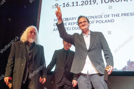 Stock Photo of American cinematographer Robert Richardson (L) and US film director Quentin Tarantino (R) join the closing gala of the 27th edition of the EnergaCamerimage Festival, in Torun, Poland, 16 November 2019 (issued 17 November 2019). Richardson and Tarantino were honored with the festival's director-cinematographer duo award. The film festival ran from 09 to 16 November 2019.