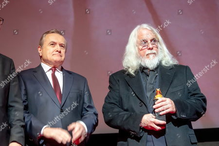 Stock Picture of American cinematographer Robert Richardson (R) and Polish Deputy Prime Minister and Minister of Culture Piotr Glinski (L) listen to US film director Quentin Tarantino (not pictured) speaking at the closing gala of the 27th edition of the EnergaCamerimage Festival, in Torun, Poland, 16 November 2019 (issued 17 November 2019). Richardson and Tarantino were honored with the festival's director-cinematographer duo award. The film festival ran from 09 to 16 November 2019.