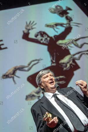 Stock Image of US film director and cinematographer John Bailey speaks during the closing gala of the 27th edition of the EnergaCamerimage Festival, in Torun, Poland, 16 Noveber 2019 (issued 17 November 2019). Sher was presented with the 'Golden Frog' award for the film 'Joker'. The film festival ran from 09 to 16 November 2019.