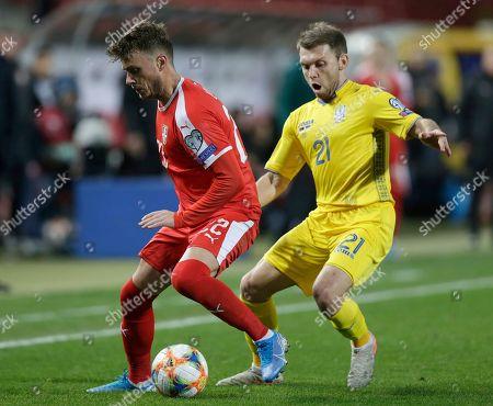 Serbia's Adem Ljajic (L) in action against UkraineÕs Oleksandr Karavaev (R) during the UEFA EURO 2020, Group B qualifying soccer match between Serbia and Ukraine, in Belgrade, Serbia, 17 November 2019.