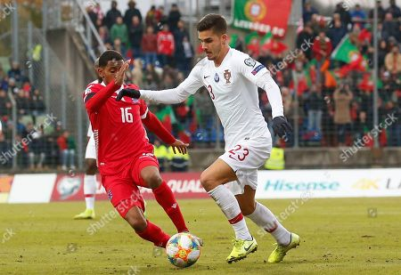 Luxembourg's Leandro Barreiro Martins (L) in action against Portugal's Andre Silva (R) during the UEFA Euro 2020 Qualifying round Group B match between Luxembourg and Portugal in Luxembourg, 17 November 2019.
