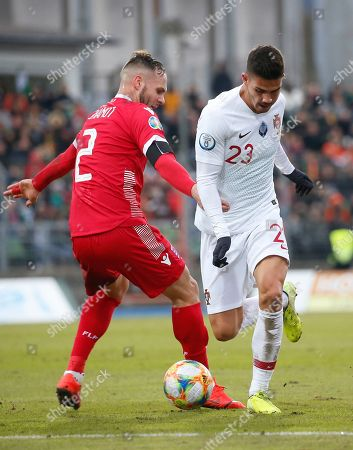 Luxembourg's Maxime Chanot (L) in action against Portugal's Andre Silva (R) during the UEFA Euro 2020 Qualifying round Group B match between Luxembourg and Portugal in Luxembourg, 17 November 2019.