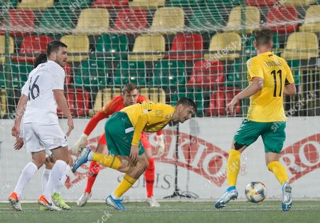New Zealand's Tim Payne, left, and goalkeeper Michael Woud is challenged by Lithuania's Paulius Golubickas, second from right, and Arvydas Novikovas during the international friendly soccer match between Lithuania and New Zealand at LFF stadium in Vilnius