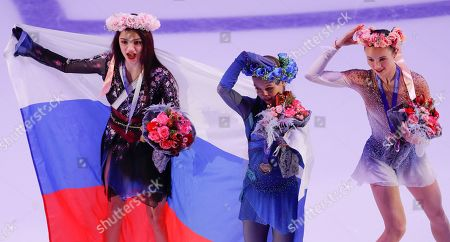 Second place winner Evgenia Medvedeva of Russia (L) and /first place winner Alexandra Trusova of Russia (C) and third place winner Mariah Bell (R) of US attend award ceremony of the 2019 Rostelecom Cup of Russia ISU Grand Prix of Figure Skating in Moscow, Russia, 17 November 2019.