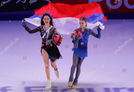 Second place winner Evgenia Medvedeva of Russia (L) and /first place winner Alexandra Trusova of Russia (R) attend award ceremony of the 2019 Rostelecom Cup of Russia ISU Grand Prix of Figure Skating in Moscow, Russia, 17 November 2019.