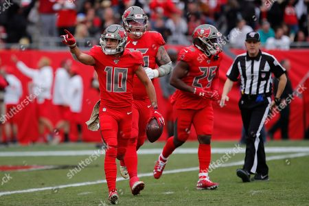 Stock Picture of Tampa Bay Buccaneers wide receiver Scott Miller (10) celebrates a reception against the New Orleans Saints during the first half of an NFL football game, in Tampa, Fla