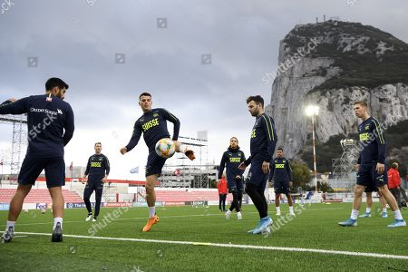 Switzerland's midfielder Granit Xhaka, third-left, and his teammates Eray Coemert, left, Stephan Lichtsteiner, second-left, Michael Lang, center, Renato Steffen, second-right, and Cedric Itten, right, during a training session one day prior to the UEFA Euro 2020 qualifying Group D soccer match between Gibraltar and Switzerland, at the Victoria Stadium, in Gibraltar, 17 November 2019.