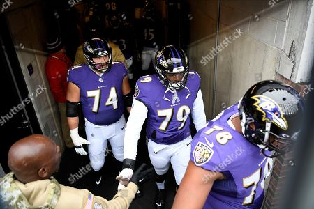 Stock Picture of Baltimore Ravens offensive tackle James Hurst (74), offensive tackle Ronnie Stanley (79) and offensive tackle Orlando Brown (78) take the field prior to an NFL football game against the Houston Texans, in Baltimore