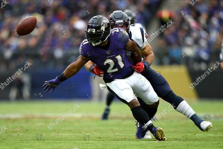 Baltimore Ravens running back Mark Ingram (21) tries to catch a pass as Houston Texans linebacker Dylan Cole defends during the first half of an NFL football game, in Baltimore