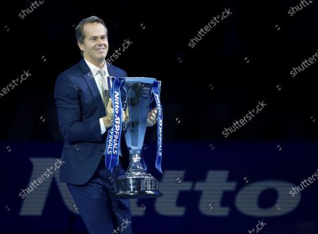 Former Champion Stefan Edberg (SWE) enter the court with the ATP Finals Trophy