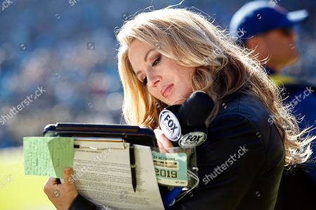 FOX field reporter Jennifer Hale works the sidelines during the second half of an NFL football game between the Carolina Panthers and the Atlanta Falcons in Charlotte, N.C
