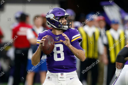 Minnesota Vikings quarterback Kirk Cousins throws a pass during the first half of an NFL football game against the Denver Broncos, in Minneapolis