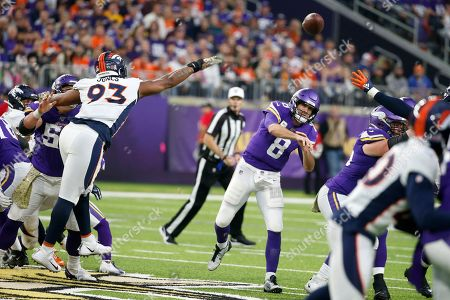 Minnesota Vikings quarterback Kirk Cousins (8) throws a pass over Denver Broncos defensive end Dre'Mont Jones (93) during the second half of an NFL football game, in Minneapolis