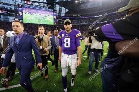 Minnesota Vikings quarterback Kirk Cousins (8) walks off the field after an NFL football game against the Denver Broncos, in Minneapolis. The Vikings won 27-23