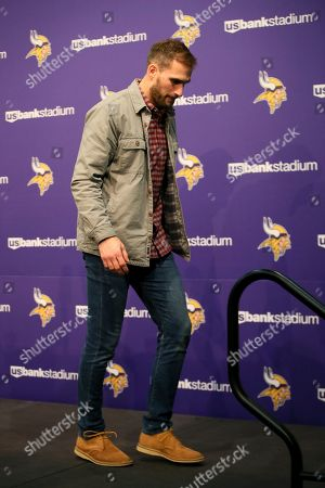 Minnesota Vikings quarterback Kirk Cousins walks away from the podium after speaking at a news conference after an NFL football game against the Denver Broncos, in Minneapolis. The Vikings won 27-23