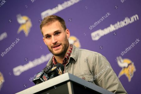 Stock Picture of Minnesota Vikings quarterback Kirk Cousins speaks during a news conference after an NFL football game against the Denver Broncos, in Minneapolis. The Vikings won 27-23