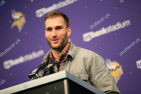 Minnesota Vikings quarterback Kirk Cousins speaks during a news conference after an NFL football game against the Denver Broncos, in Minneapolis. The Vikings won 27-23
