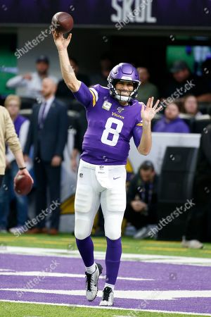 Minnesota Vikings quarterback Kirk Cousins warms up before an NFL football game against the Denver Broncos, in Minneapolis