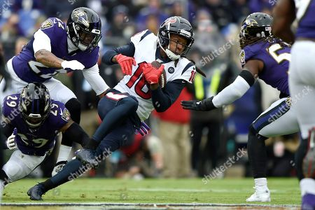 Houston Texans wide receiver DeAndre Hopkins (10) pushes forward after a catch as Baltimore Ravens free safety Earl Thomas (29), cornerback Jimmy Smith (22) and middle linebacker Josh Bynes (57) try to stop him during the first half of an NFL football game, in Baltimore