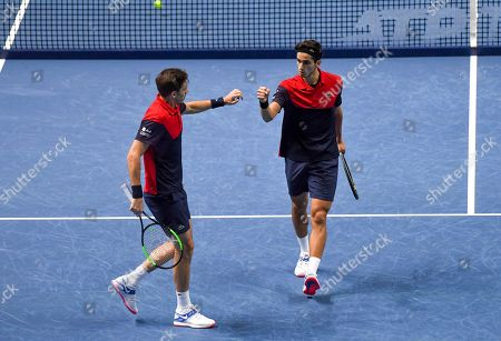 Pierre-Hugues Herbert and Nicolas Mahut of France celebrate winning a point against Raven Klaasen of South Africa and Michael Venus of New Zealand during their ATP World Tour Finals singles tennis match at the O2 Arena in London
