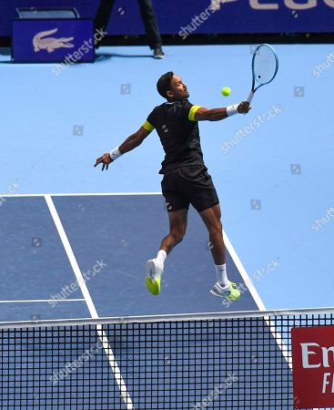 Raven Klaasen of South Africa and Michael Venus of New Zealand play a return to Pierre-Hugues Herbert and Nicolas Mahut of France during their ATP World Tour Finals singles tennis match at the O2 Arena in London
