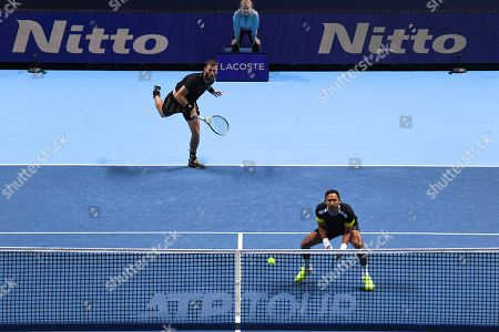 Raven Klaasen of South Africa and Michael Venus of New Zealand serve to Pierre-Hugues Herbert and Nicolas Mahut of France during their ATP World Tour Finals singles tennis match at the O2 Arena in London