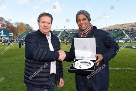 Stock Picture of Simon Halliday presents Jeremy Guscott with a silver salver to commemorate the winners of the European Cup in its 25 year history