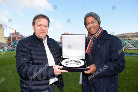 Simon Halliday presents Jeremy Guscott with a silver salver to commemorate the winners of the European Cup in its 25 year history