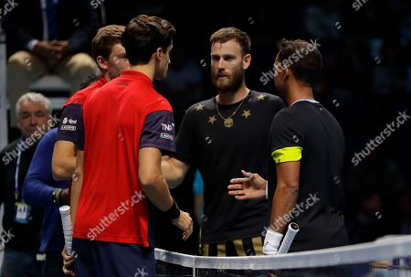 Pierre-Hugues Herbert of France, second left and Nicholas Mahut of France, left, shake hand with Raven Klaasen, right, of South Africa and Michael Venus of New Zealand, after they won the ATP World Finals final doubles tennis match at the O2 arena in London