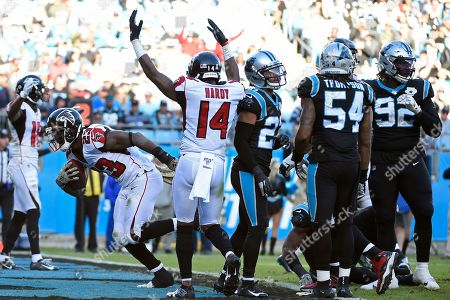 Stock Picture of Atlanta Falcons running back Brian Hill (23) scores a touchdown against the Carolina Panthers while wide receiver Justin Hardy (14) reacts during the second half of an NFL football game in Charlotte, N.C